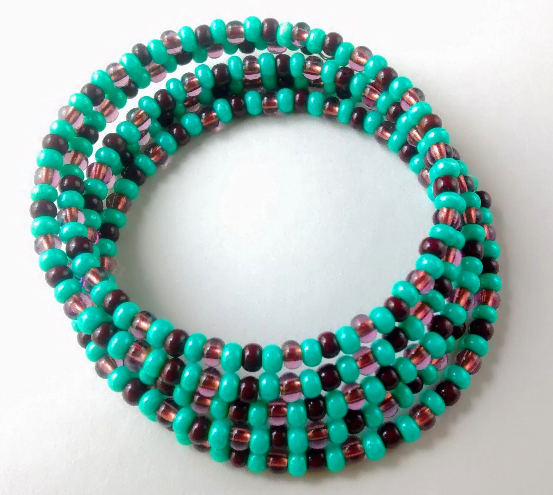 Five coil round memory wire bracelet and wraps around your wrist for 37 inches total. Beads: Turquoise and brown opaque luster seed beads; Brown transparent luster seed beads No clasp is needed as the