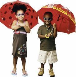 Kids with our Kidorable Ladybug and Fireman umbrellas