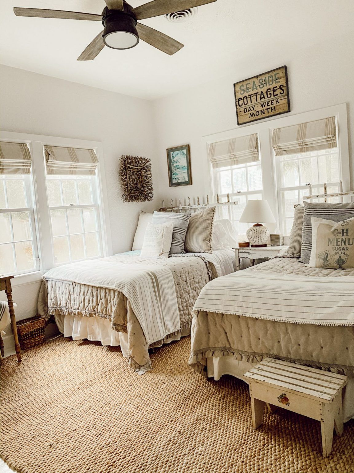 A coastal cozy white cottage diy farmhouse bedroom