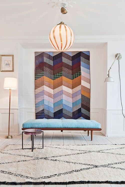 The quilt, the pendant light, the rug: All of this please!