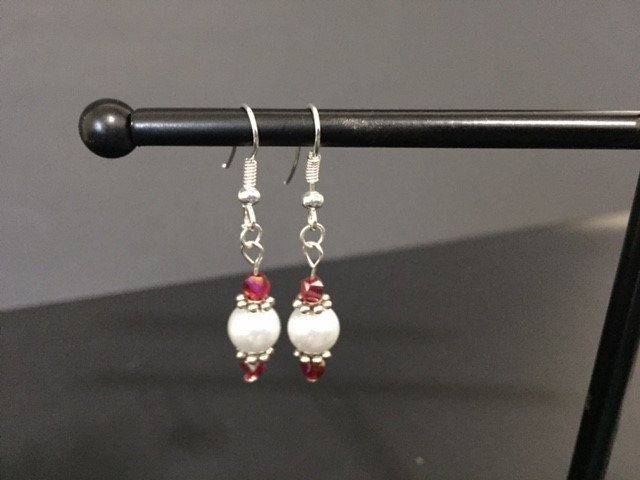 A personal favorite from my Etsy shop https://www.etsy.com/listing/504002199/swarovski-red-and-pearl-earrings