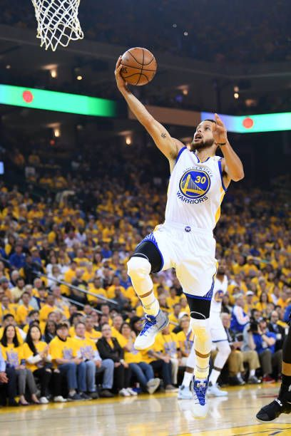 Stephen Curry of the Golden State Warriors goes up for a layup against the  San Antonio Spurs during Game One of the NBA Western Conference Finals at. 4c8a724764667