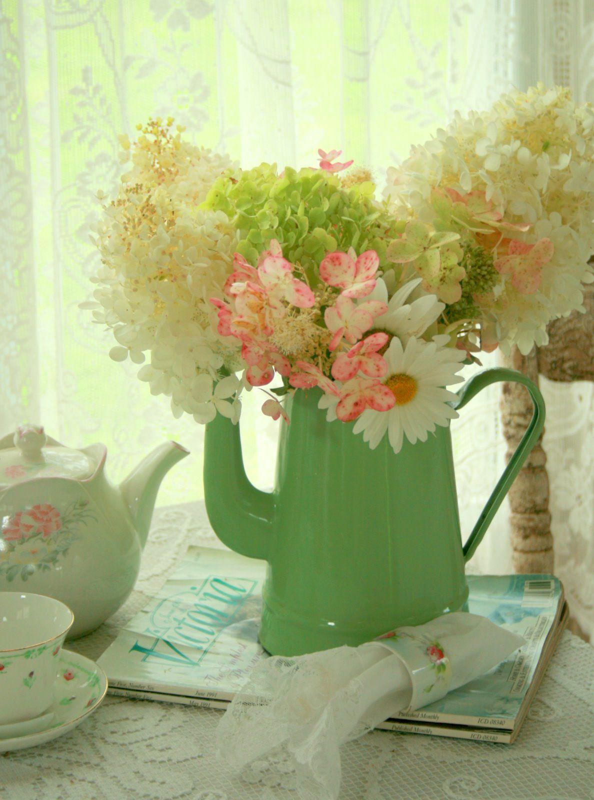 Aiken House & Gardens ~ flowers in coffee pot, tea set ...