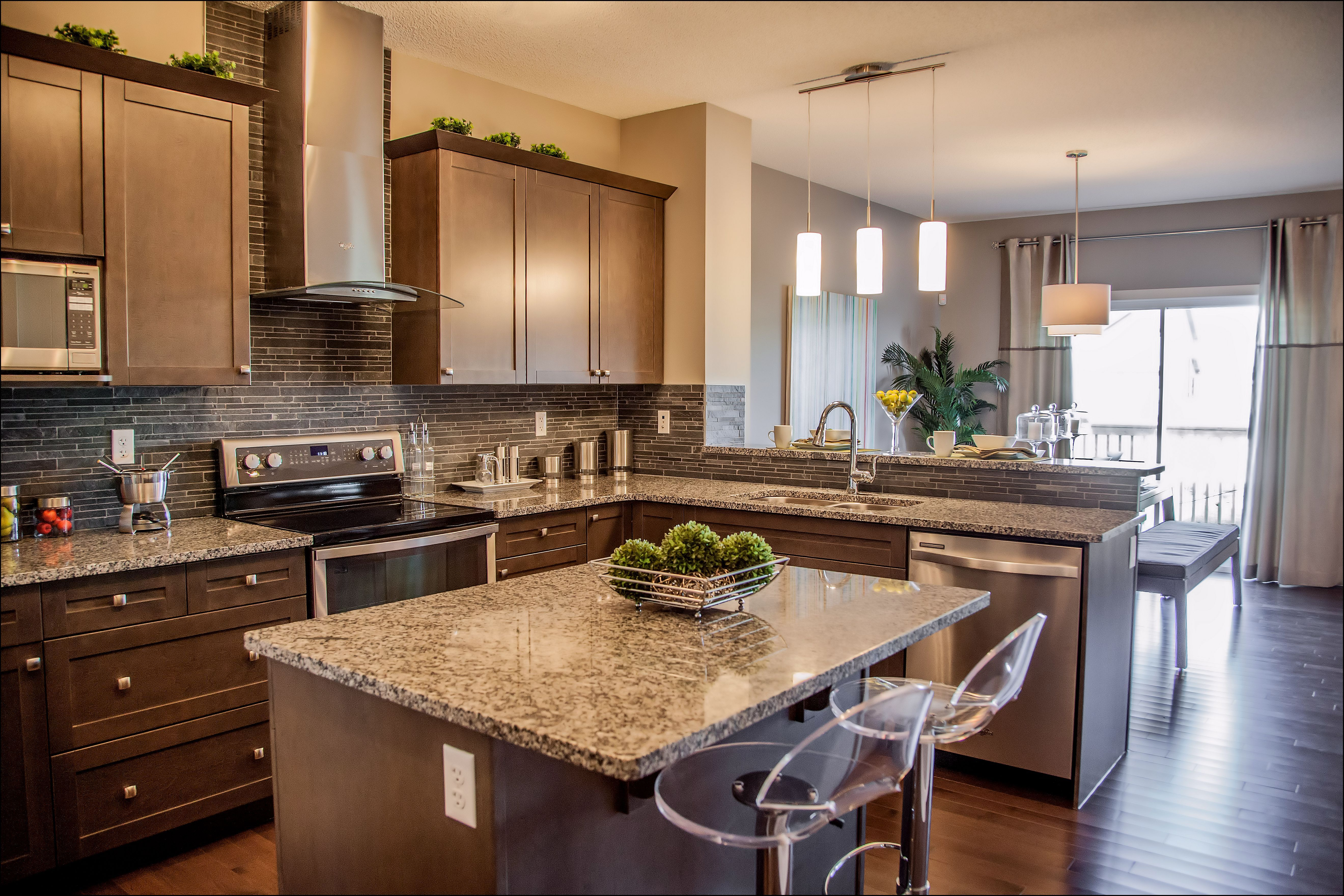 Kitchen with dark stained maple cabinets, brown granite ... on Maple Cabinets With Dark Countertops  id=79659