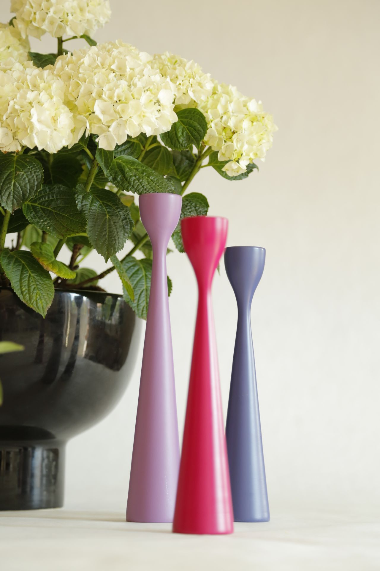 FREEMOVER.se - Scandinavian MIdsummer  - Rolf™ Wooden Candlesticks in New Mid-Century Modern Design by Maria Lovisa Dahlberg. 40 colors; Fuchsia, Lilac and Blueberry blue, Raw Oak and Certified Teak. Celebrating 10.