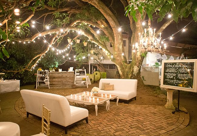 Aaron Delesie Photography // The Knot Blog - love the lights and the white couches... So unexpected, but beautiful