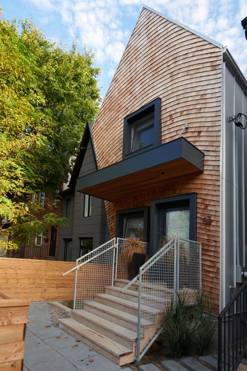 Wood Shingles Cover The Facade Of This Curvy Canadian House Architecture Roof Design Canadian House