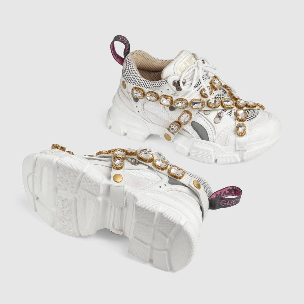 8bae722c8cd Shop the Flashtrek sneaker with removable crystals by Gucci. Sparkling  crystals are embroidered onto a removable elastic strap, wrapping around  these ...