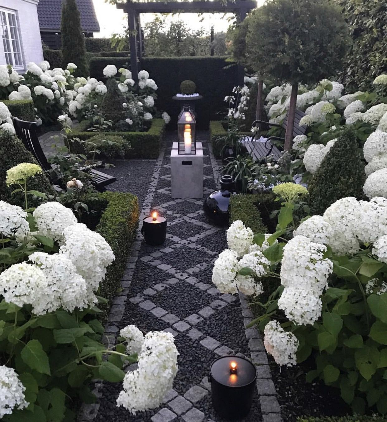 White Hydrangeas Add Interest And Structure To This Small