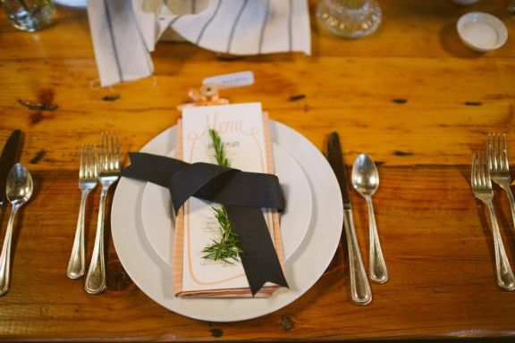 napkins with card and silverware with flower?