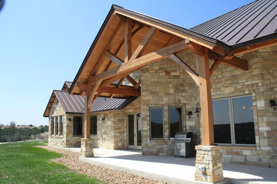 Texas timber frames residential hill country home photo for Hill country stone