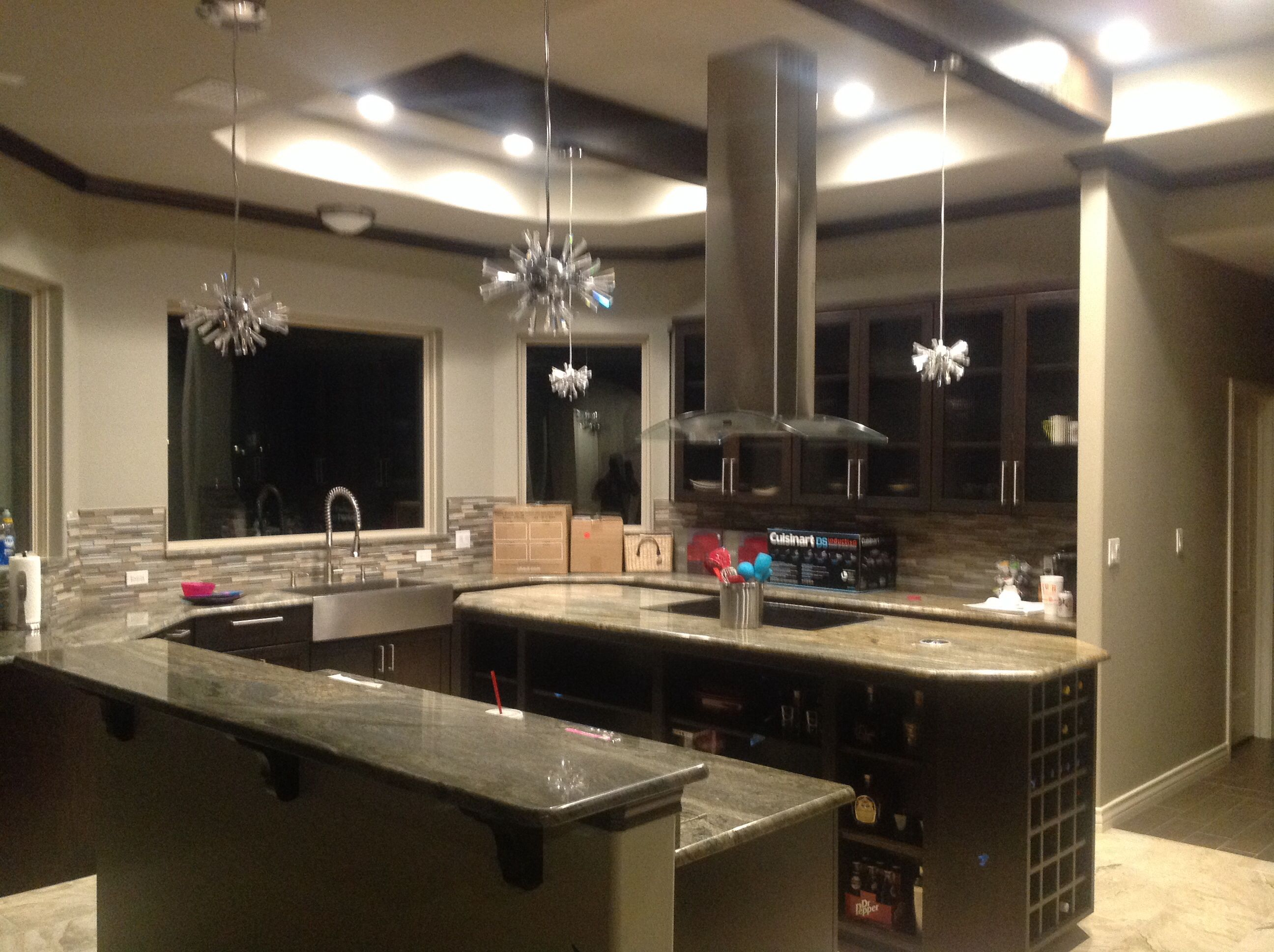 Octagon Elongated Island Kitchen Shape Dark Wood Ceiling Beams Match The Lower Cabinets Not Lit In This Picture Are 4 Radiant Crystal Fixtures That