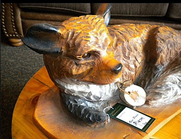 Adorable fox chainsaw carving made in minnesota by a