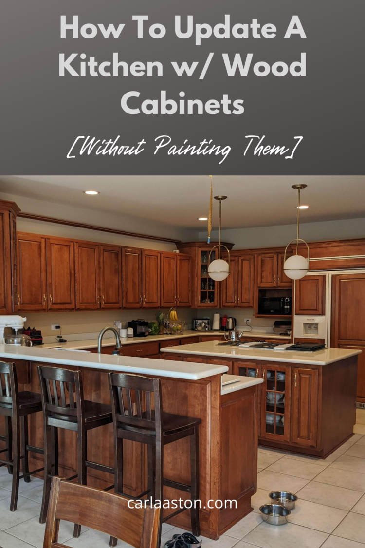 How To Update A Kitchen With Wood Cabinets Without Painting Them Designed In 2020 Wood Kitchen Cabinets Wood Cabinets Top Kitchen Trends