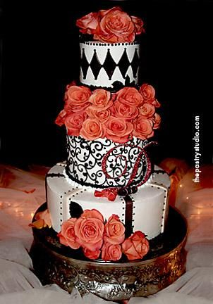 Chocolate, ivory and burnt orange are the colors used in this design. the cake was beautiful and rich with black harlequin diamonds and scroll work finished with a custom crystal monogram.