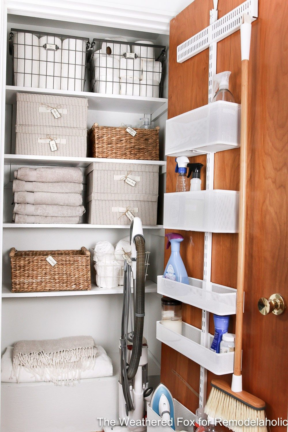 get organized! this linen closet makeover features an adjustable over the door organizer for