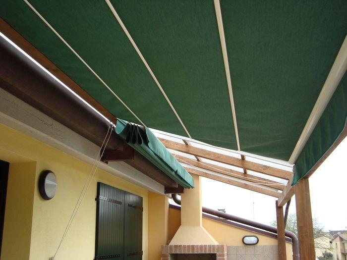 Amalegno:Pergola con copertura in tenda scorrevole