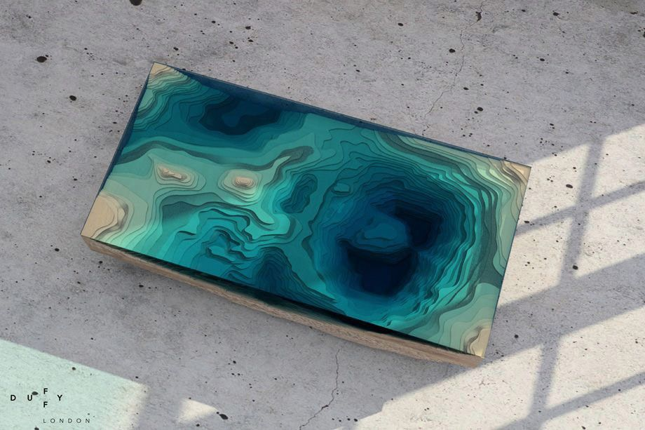 Incredible Layered Glass Sculptures That Mimic The Ocean Photos - Incredible layered glass table mimics oceans depths