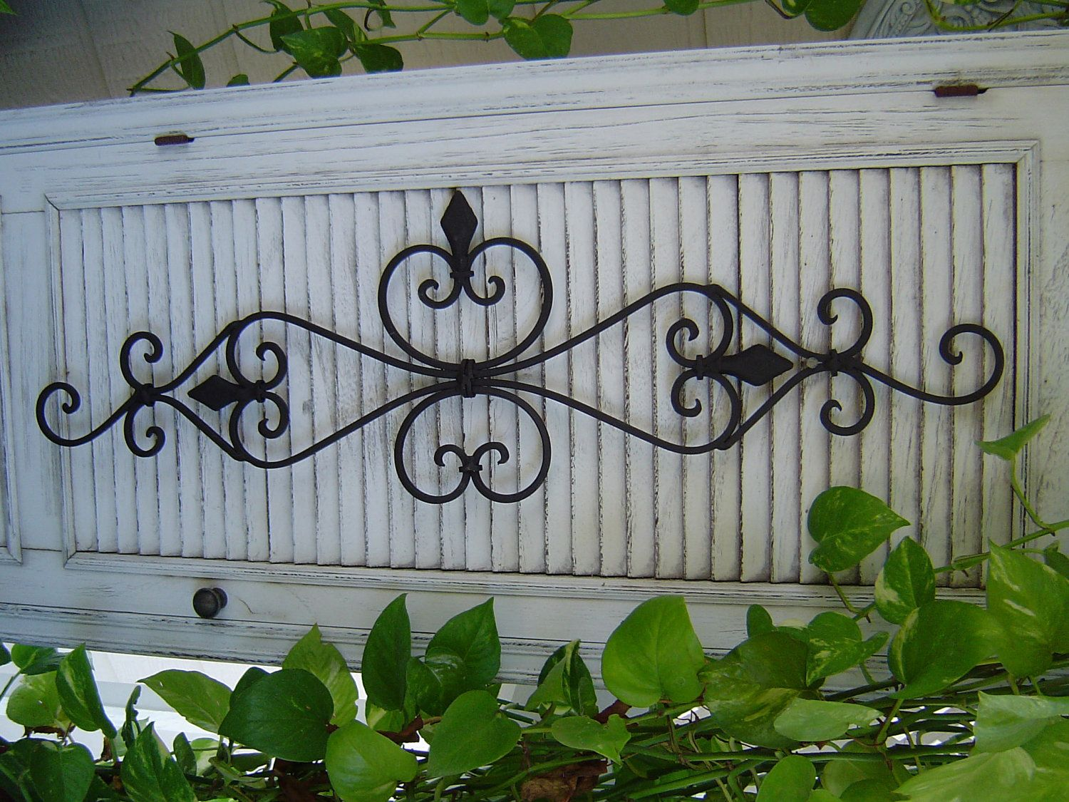 Wrought Iron Scroll Wall Decor Contemporary Yet Rustic The Layered Circle Iron Wall Plaque Is