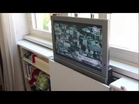 verstecken sie den fernseher mit dieser genialen. Black Bedroom Furniture Sets. Home Design Ideas
