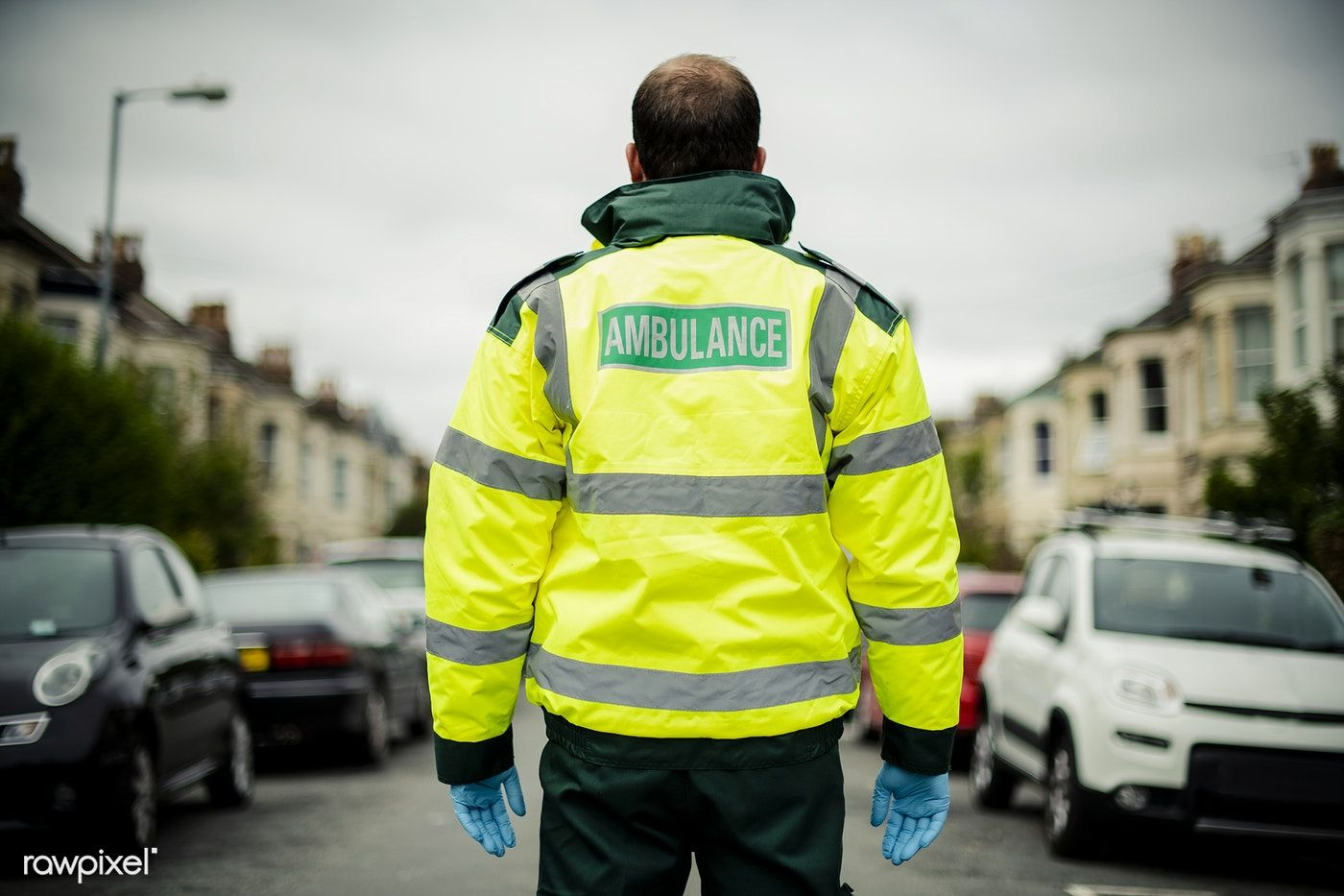 Download premium image of portrait of a male paramedic in