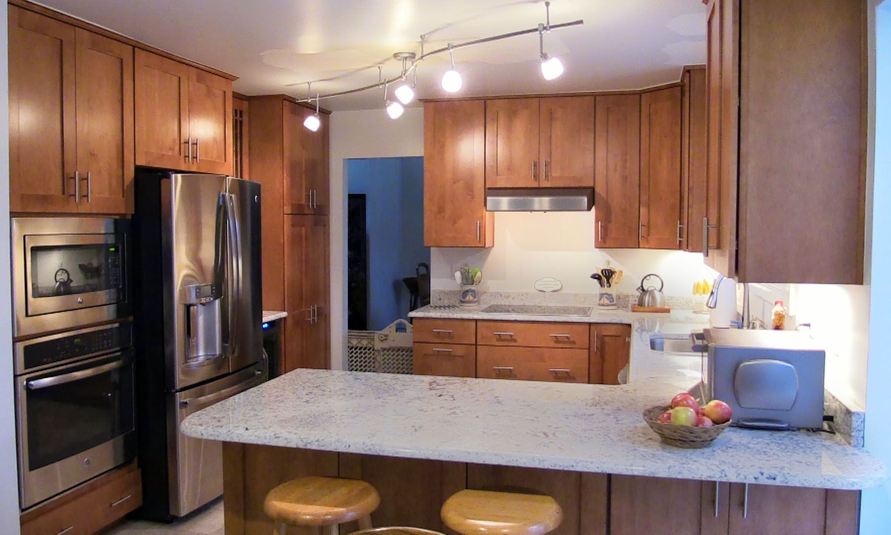 White Ice Granite countertop with Maple Autumn Haze ... on Maple Kitchen Cabinets With Granite Countertops  id=94319