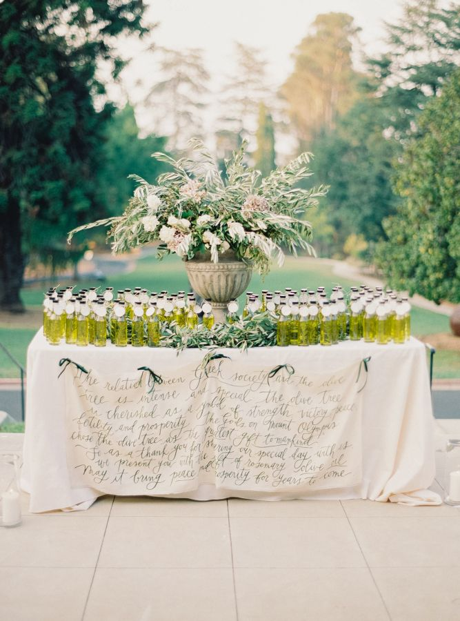 Elegant olive oil favor display: http://www.stylemepretty.com/2016/02/16/english-garden-style-wedding-in-california/   Photography: Michele Beckwith - http://michelebeckwith.com/