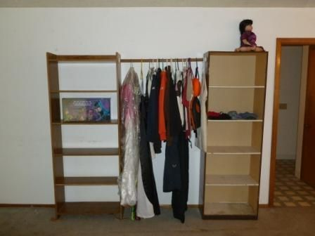 Idea For DIY Free Standing Closet: Two Bookshelves With A Bar Across The Top