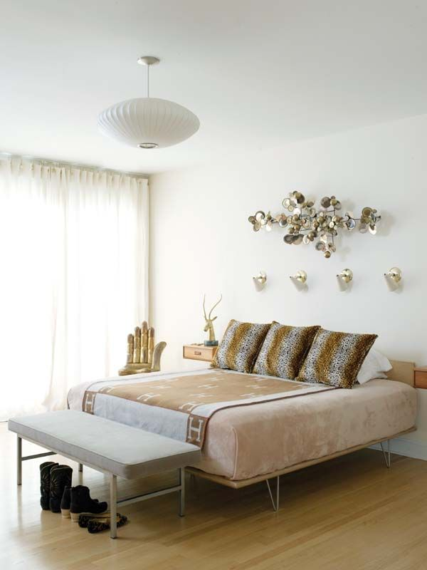 Mid-century modern glam bedroom, Hermes Avalon throw, fur pillows, C. Jere wall art, Nelson lamp, hand chair, Kristin Gallipoli