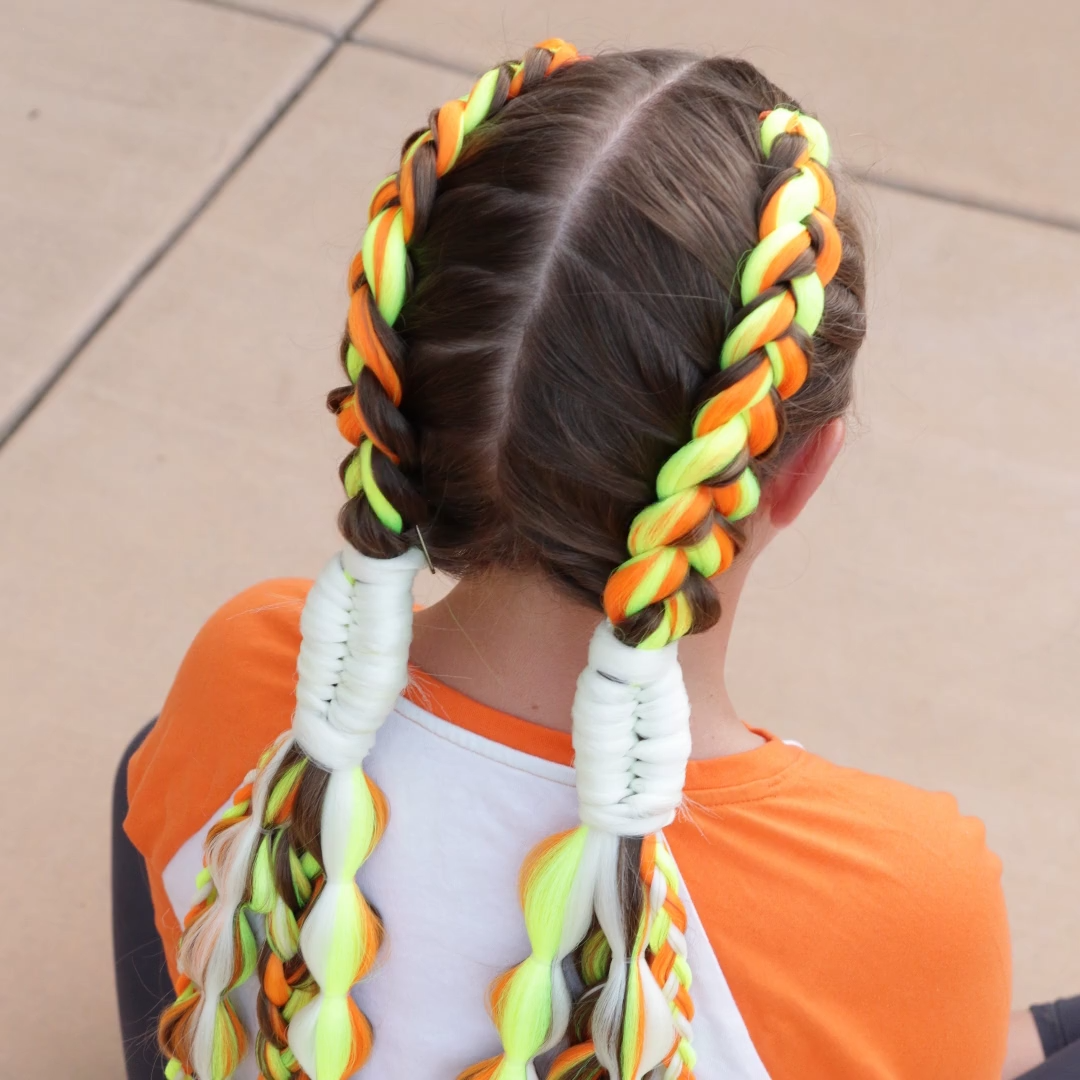 Here is a fun mixed braid style for Halloween using three different colors of Kanekalon Hair. To see more hair tutorials head to my you tube channel On Hair With Erin