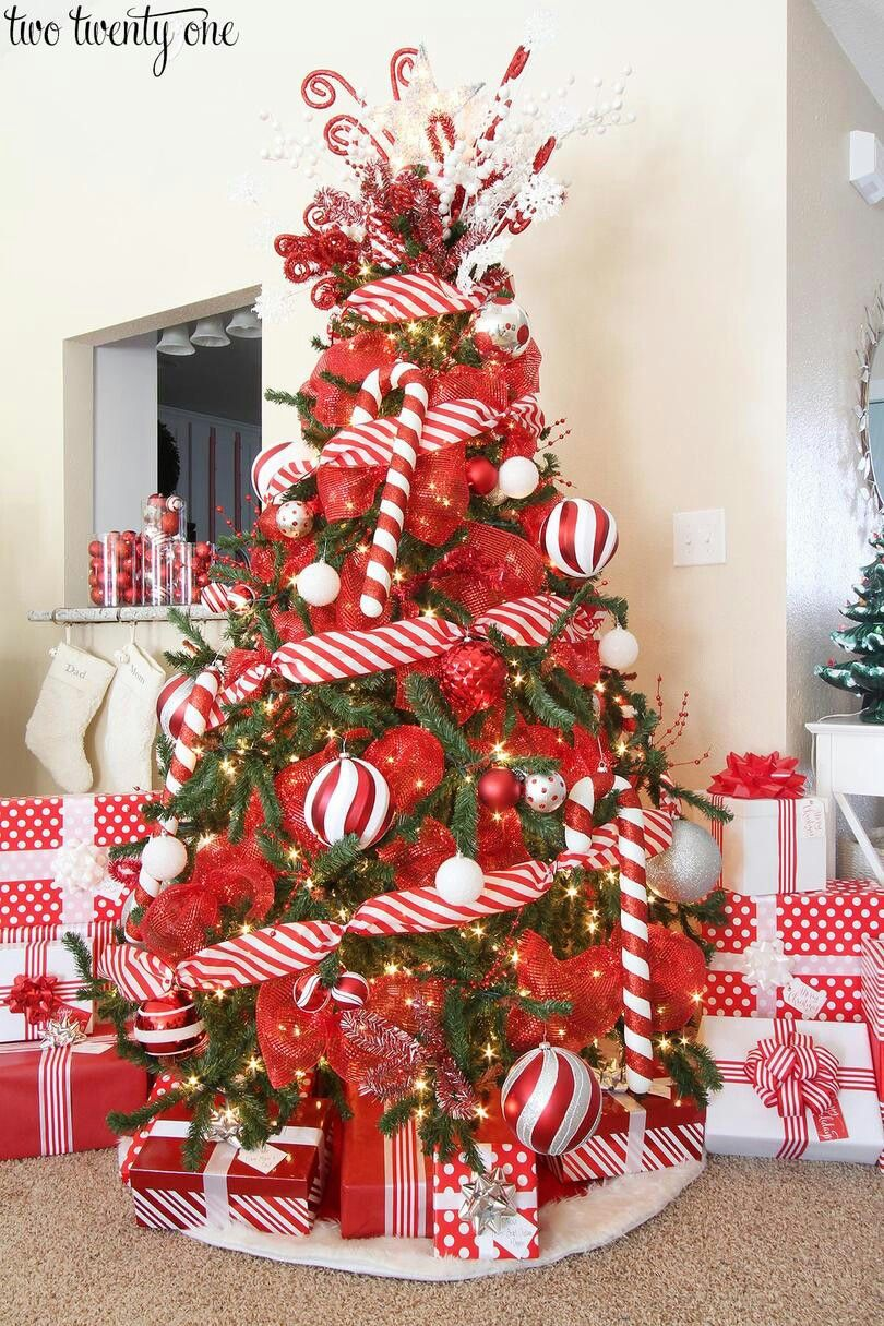 red and white christmas tree with candy cane striped ribbon red mesh ribbon ornaments and red and white wrapped christmas gifts - Christmas Tree Decorations Candy Theme