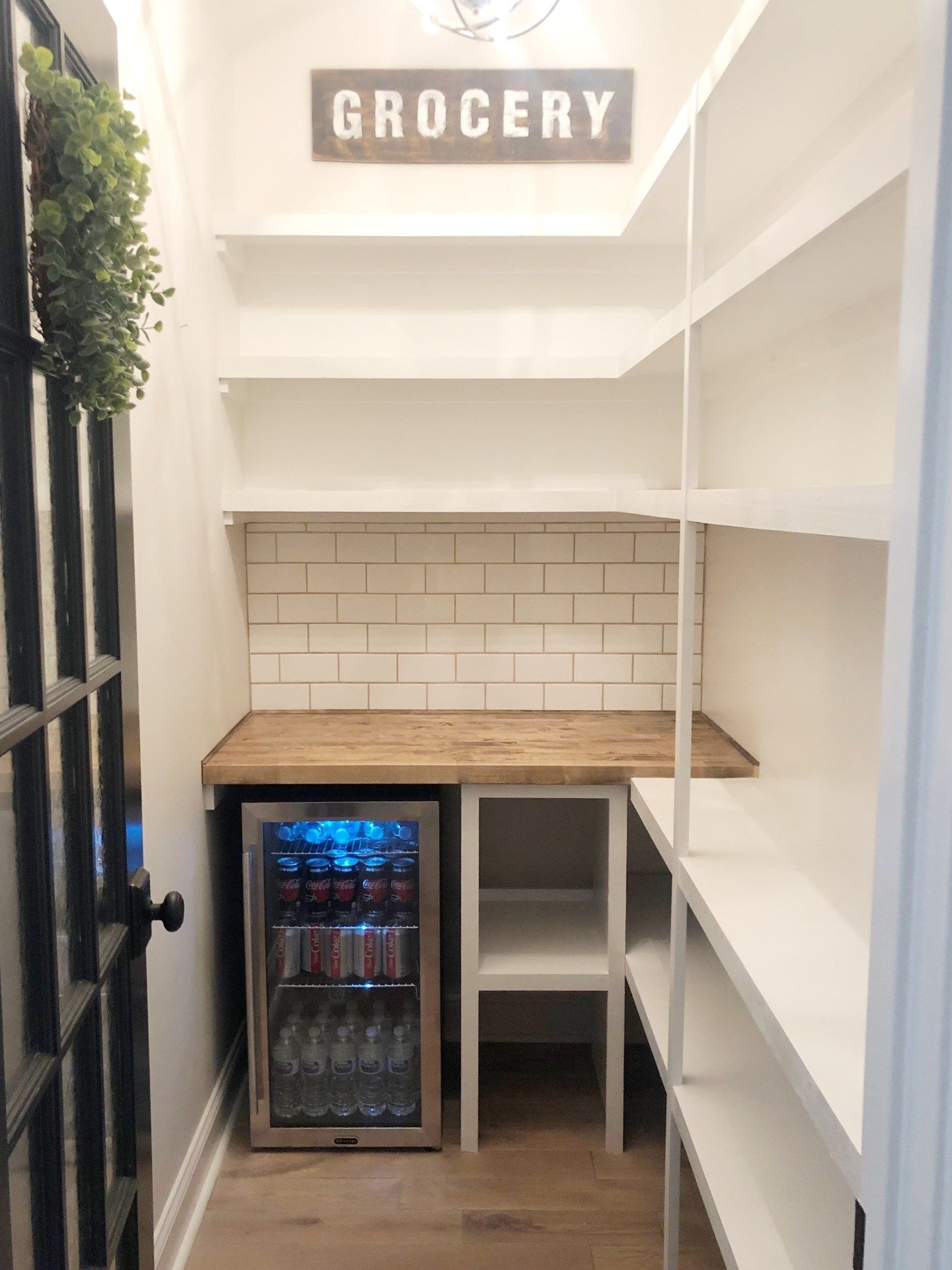 Photo of A walk in pantry makeover from builder grade to organized functionality.