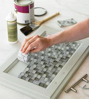Mosaic tiles on cabinet doors - interesting idea. Frosted ...