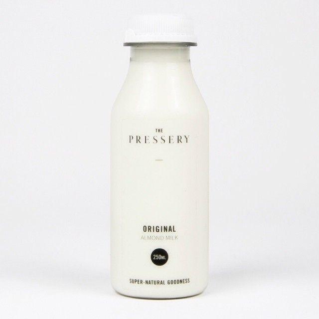 @thepressery - super natural goodness #goodswelike #almondmilk #the pressery #natural #minimal #ingredients #milk #bottle #simple #design #healthy #thepressery #london #white #organic #raw #beautiful