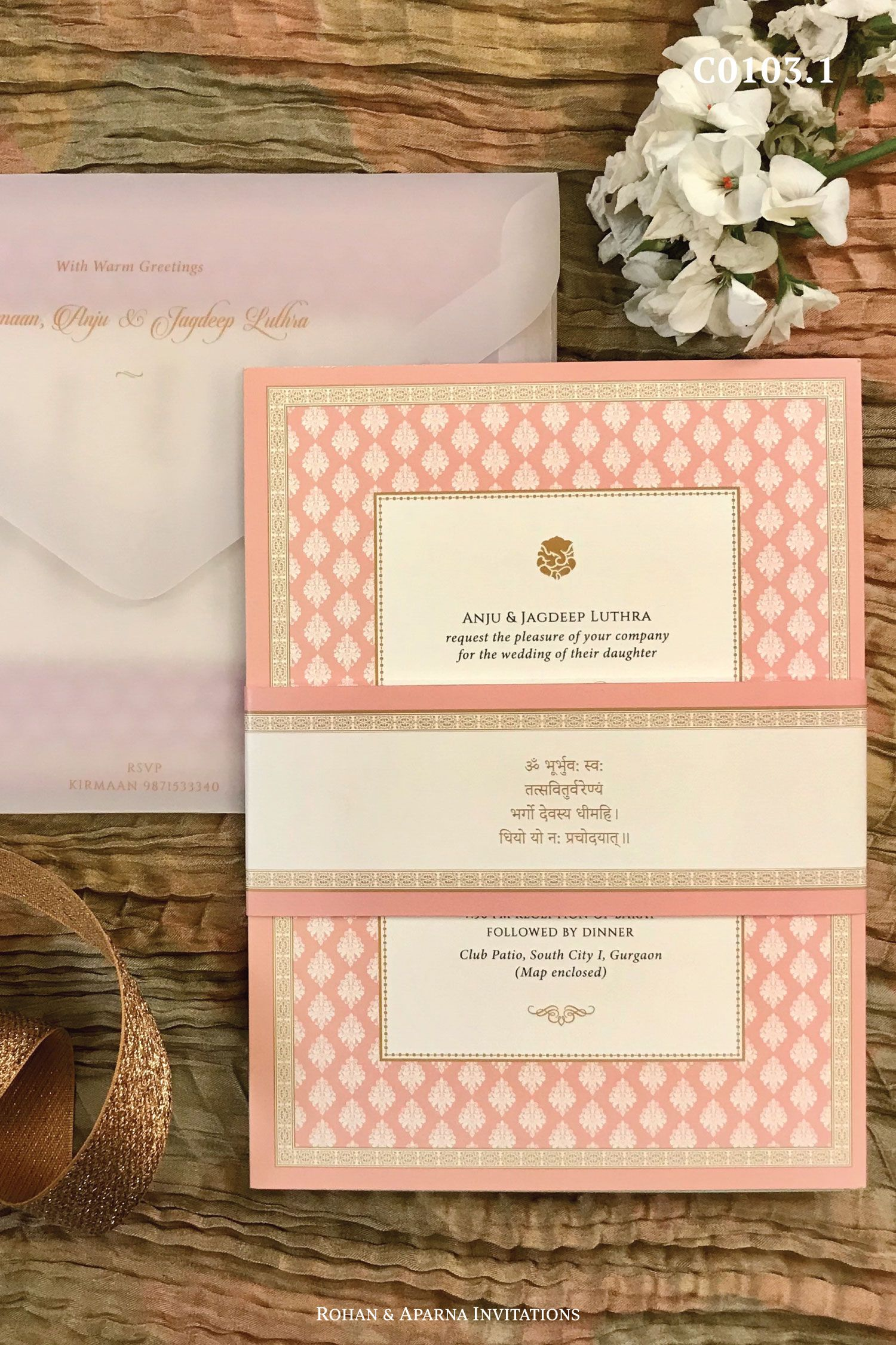 Buti patterned wedding invitation in pastel colors with a unique vellum paper envelope and a band. For more design ideas, visit www.rohanaparna.com  ——————————————— #rohanaparnainvitations #weddinginvitations #weddingcards #indianweddingcard #reception #weddingcard #shaadi #shaadicard#hinduweddingcard #mehendi #indianwedding #ecard #destinationwedding #weddingcards #royalwedding #pastelwedding #vellumenvelope #Ganeshji