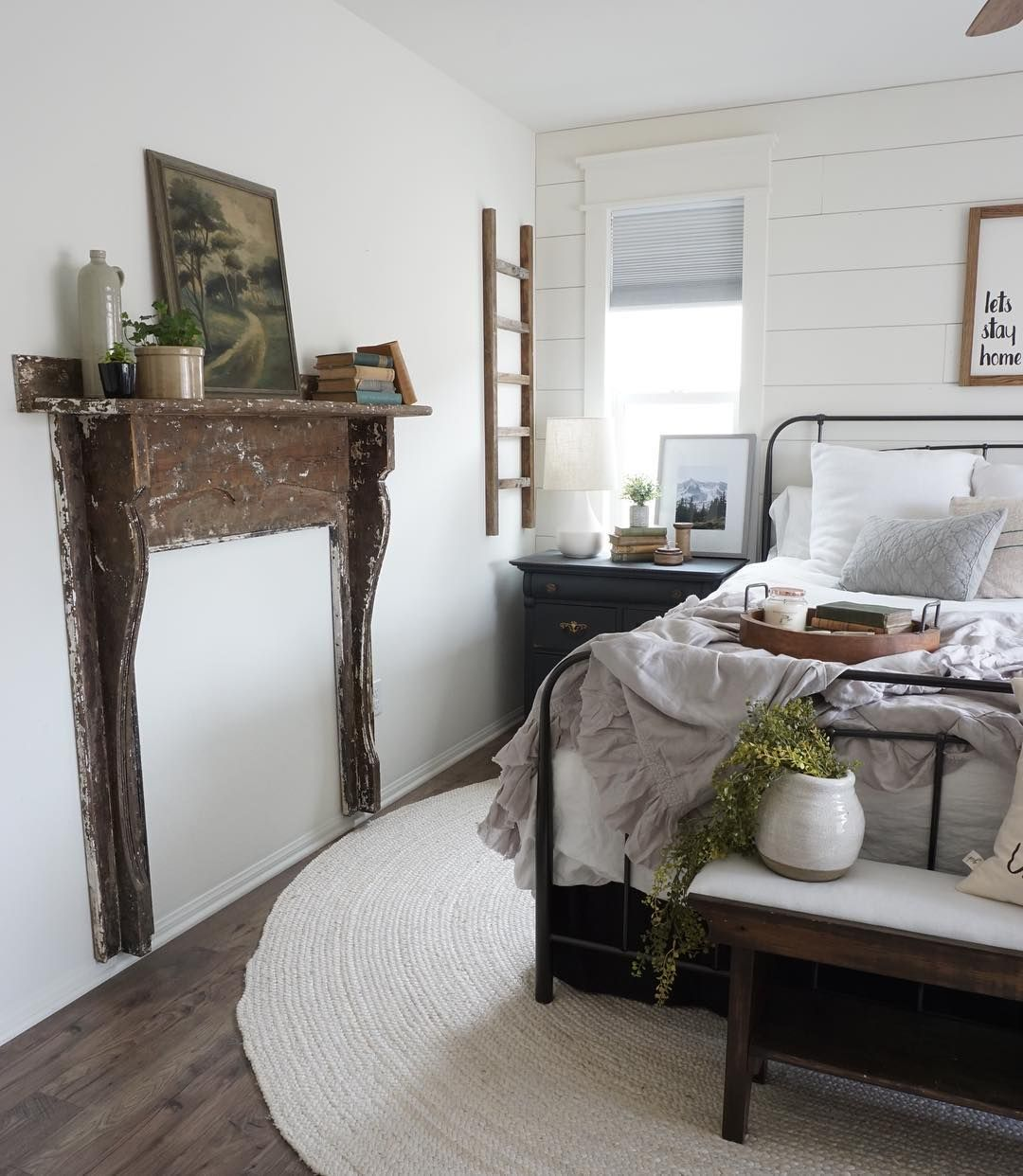i sure love this old mantel in this country farmhouse bedroom i