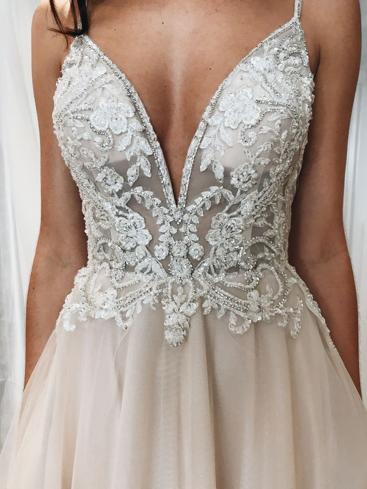 Photo of Spaghetti strap plunging v-neck lace and illusion wedding dress from David's Bri…