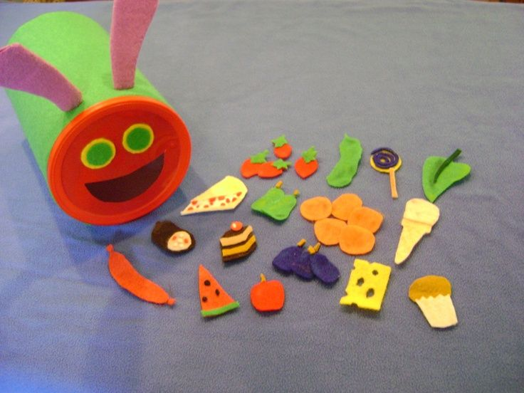 """Very Hungry Caterpillar. Have the children """"feed"""" the canister caterpillar all the felt food while you read the story. Great!"""