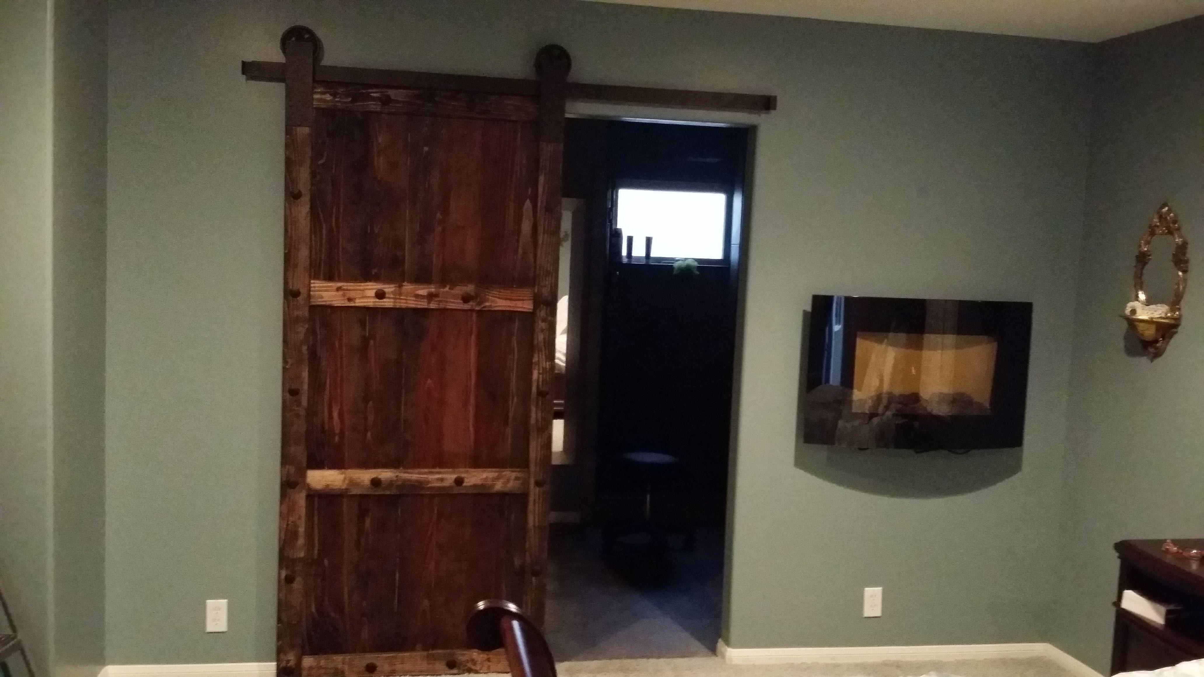 Dark stained rustic Spanish style sliding barn door using ...