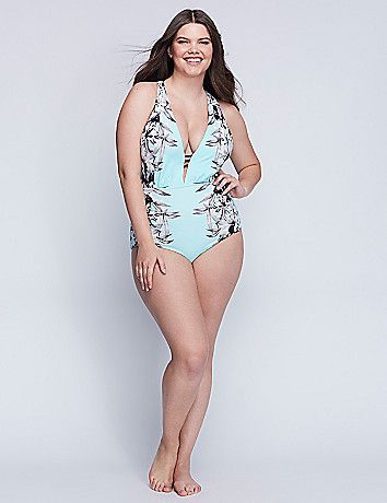 2fbfac5f26a9b This one piece specializes in the unexpected. A grayscale floral print?  Ladder-shaped neckline cutouts? Strappy back? Check, check and check. Built-in  ...