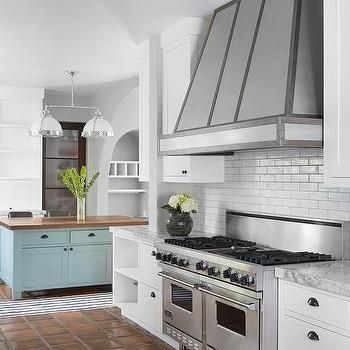 white kitchen with orange terracotta tile floor | kitchen