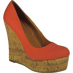 901 is a round toe platform pump on a cork wedge with a canvas upper. Available Colors: Khaki, Black, Red, Yellow, Green, Orange. $31
