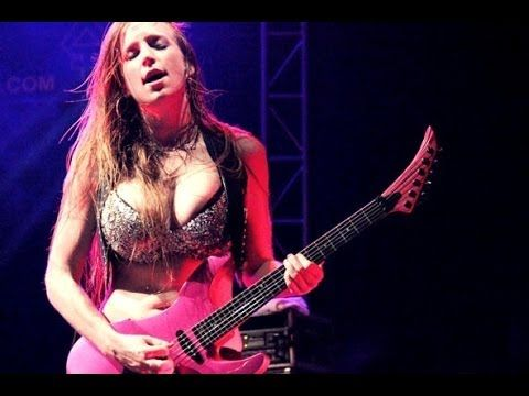 busty metal guitar chick