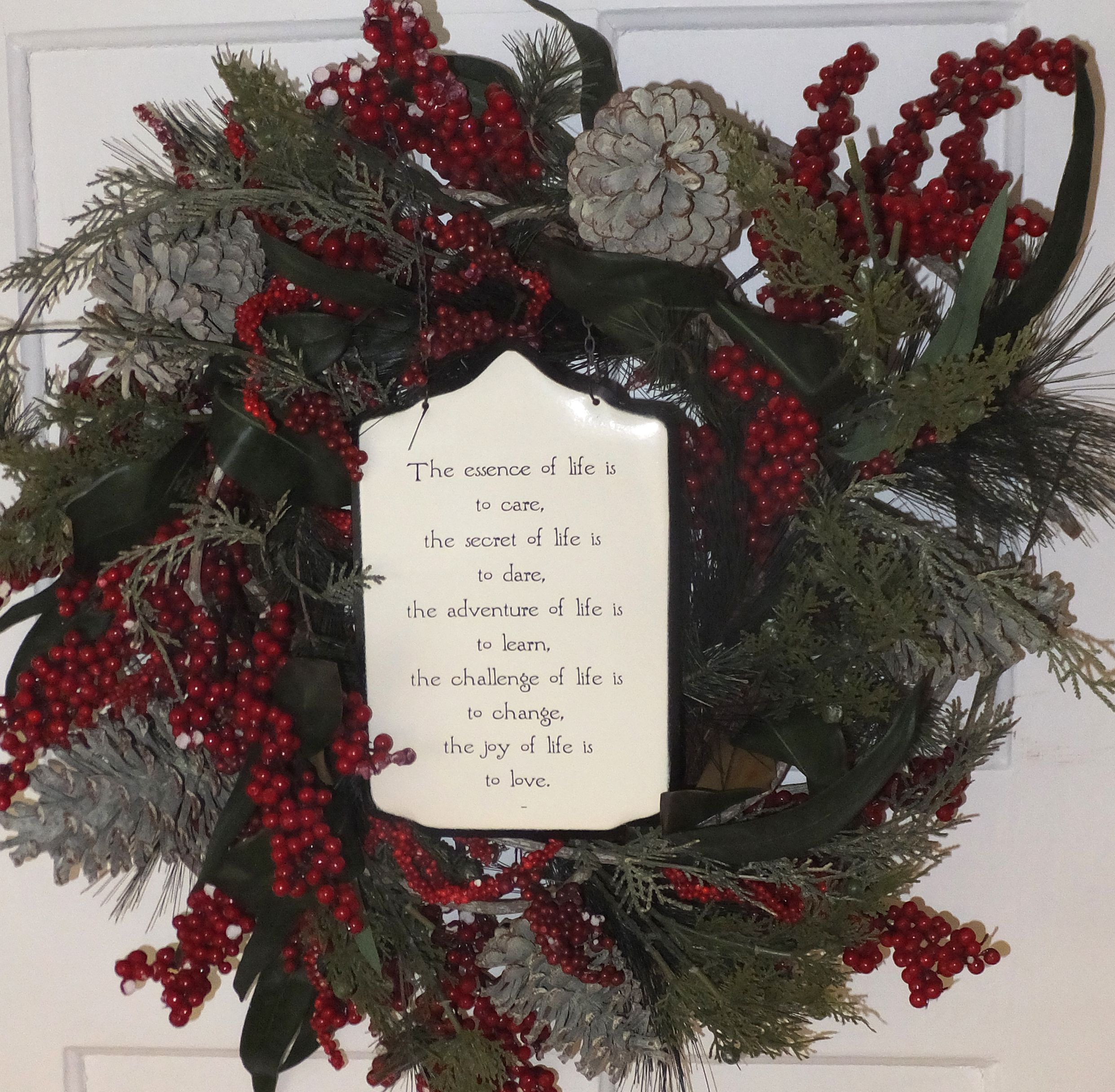 """surround a simple plaque with a seasonal wreath: it becomes a showpiece. """"The essence of life is ..."""