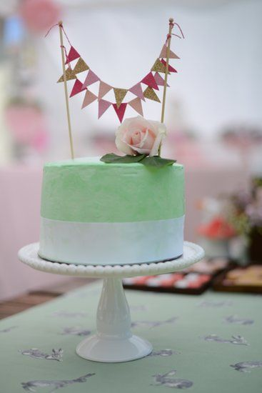 Sweet Smash Cake: Cerise's adorable smash cake was topped with bunting from Etsy's Confetti Creations.  Source: Event Head