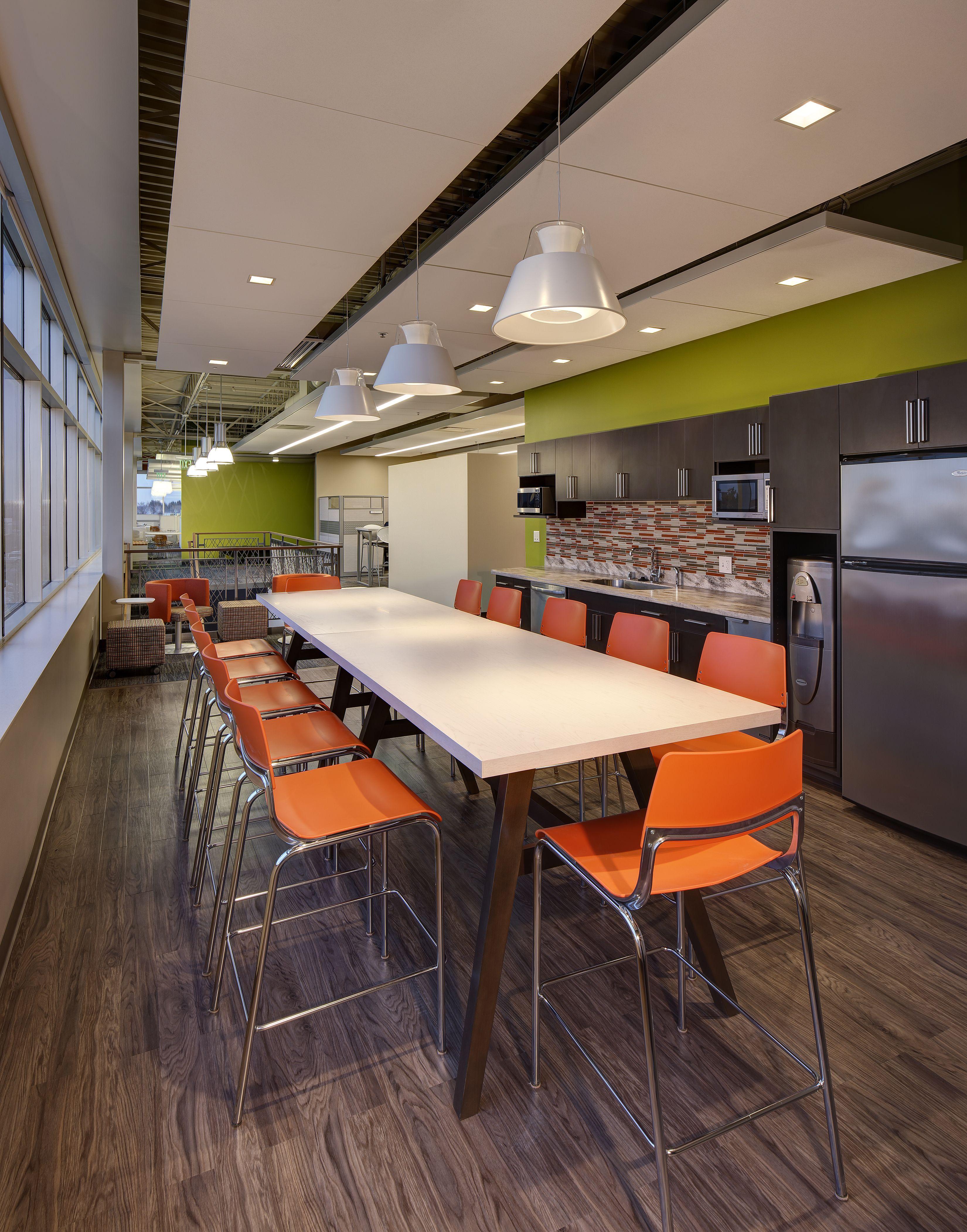Green accent in bsi 39 s employee work lounge office break - Corporate office design ideas ...