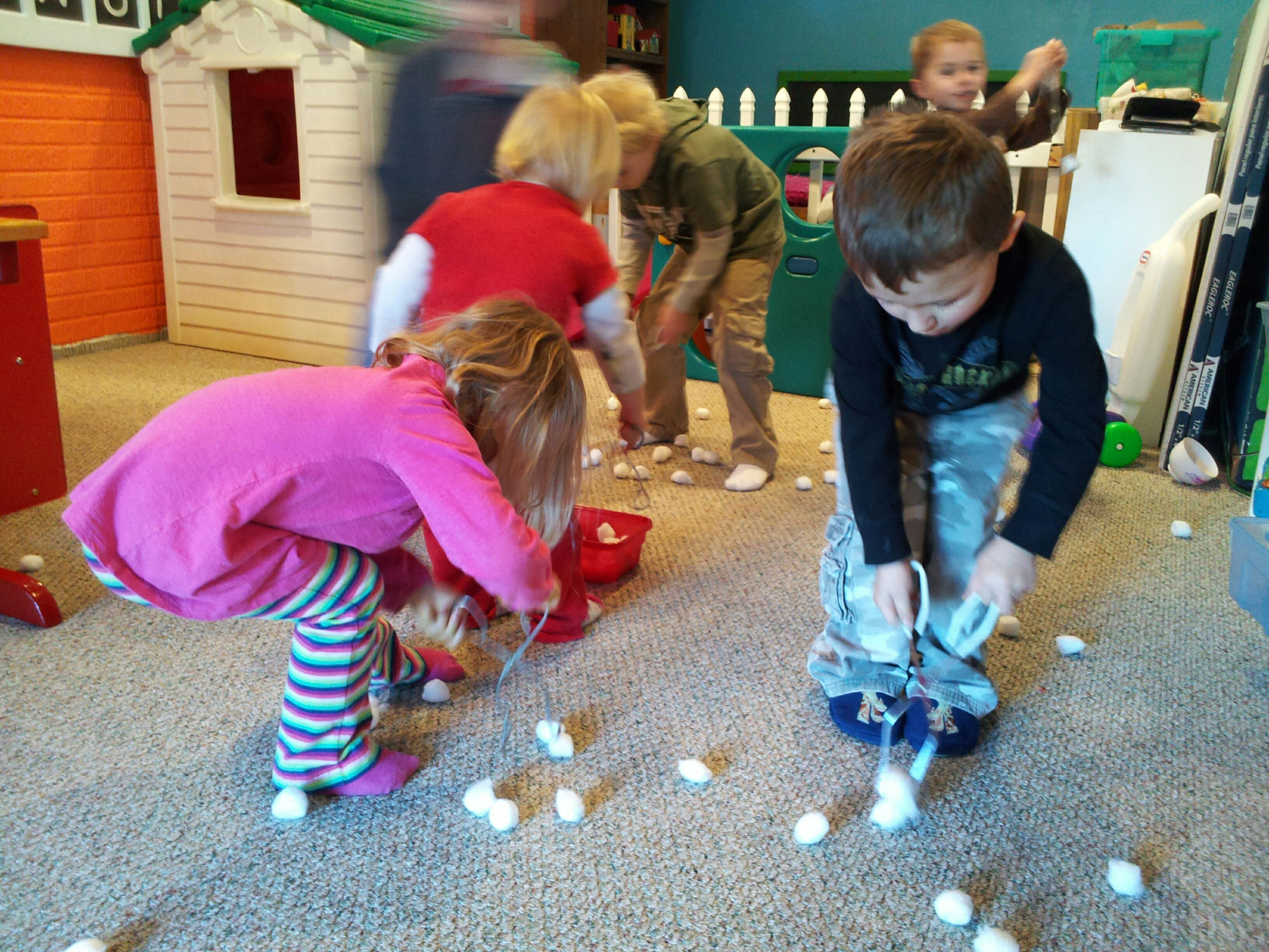 Snowball pickup. Scatter cotton balls around the room and