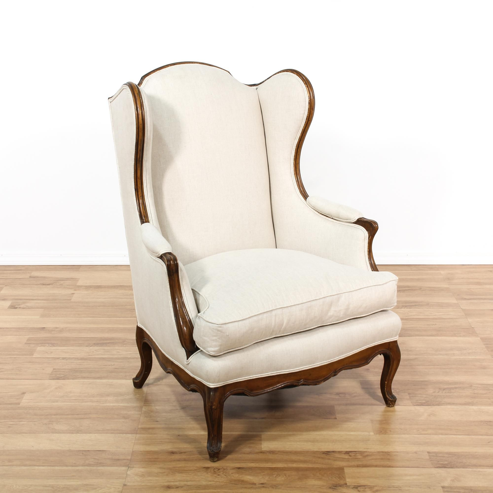 This cottage chic wingback chair is upholstered in a