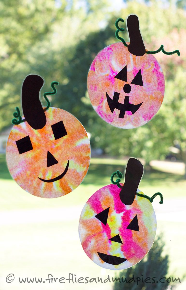 Kids will love making these easy Jack O'Lantern Suncatchers as a Halloween craft at home or school. | Fireflies and Mud Pies