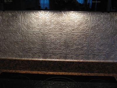 Easy economical punched tin backsplash the whole for Textured wallpaper for kitchen backsplash